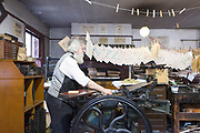 Blists Hill Victorian town, Shropshire, United Kingdom, 2017-08-31.<br /><br />Blists Hill is a recreation of a Victorian town and many of it's industries during the 18th and 19th Centuries located 3km away from Ironbridge. The museum town features the orginal blast furnace where the struts for the famous bridge were rolled, pressed and cast as well as other authentic and recreated architecture. Expert guides and demonstrators re-enact the characters and trades of the time, like wood carvers, mill workers, iron mongers, printers, locksmiths and more.