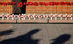 © Licensed to London News Pictures. <br /> 16/12/2014. <br /> <br /> Hartlepool, United Kingdom<br /> <br /> Wooden crosses and 130 ceramic poppies previously on display at The Tower of London are planted by school children to commemorate those killed during an event to commemorate the bombardment of Hartlepool by German warships during World War One. During the bombardment 130 civilians were killed and more than 500 were wounded. The Headland's Heugh Gun Battery returned fire in what was the only battle to be fought on British soil during World War One, and one of the Battery's soldiers, Theo Jones of the Durham Light Infantry, became the first British soldier to be killed by enemy action on home ground in the war.<br /> <br /> Photo credit : Ian Forsyth/LNP