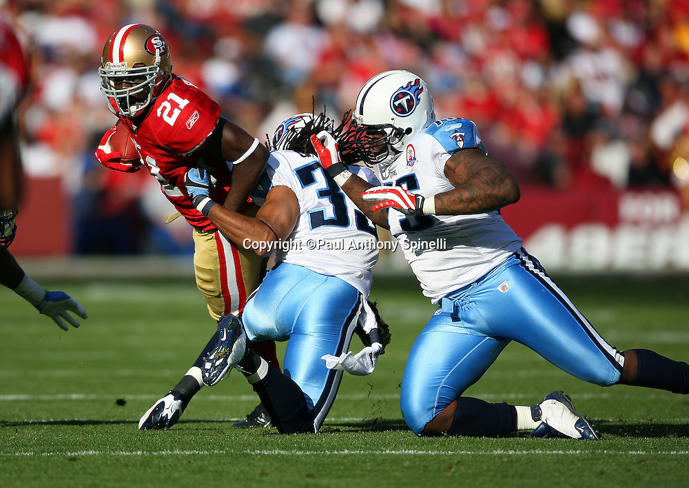 San Francisco 49ers running back Frank Gore (21) runs the ball while trying to avoid a tackle attempt by Tennessee Titans safety Michael Griffin (33) during the NFL football game against the Tennessee Titans, November 8, 2009 in San Francisco, California. The Titans won the game 34-27. (©Paul Anthony Spinelli)