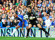 Goalkeeper Lukasz Fabianski of Arsenal collects to ball off Nicolas Anelka of Chelsea