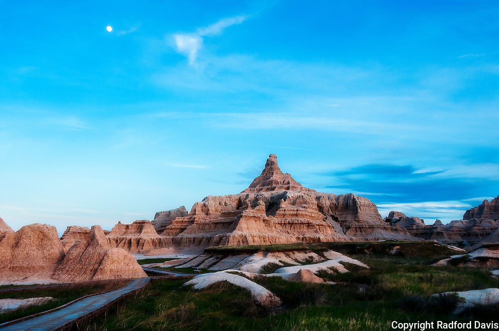 Badlands National Park, South Dakota. Sunset, with moon.