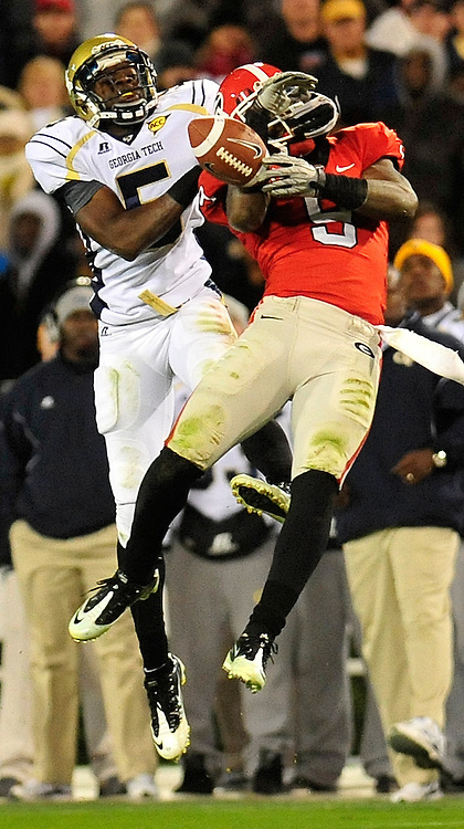 Georgia Tech Yellow Jackets wide receiver Stephen Hill (5) prevents Georgia Bulldogs safety Alec Ogletree (9) from making an interception as the Georgia Bulldogs defeat the Georgia Tech Yellow Jackets 42-34 at Sanford Stadium on Saturday, Nov.27, 2010 in Athens, Ga..