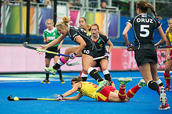 Spain's Rocio Ybarra makes a desperate tackle in the circle while Eileen Hoffmann of Germany jumps clear. Germany v Spain - 3rd/4th Playoff Unibet EuroHockey Championships, Lee Valley Hockey & Tennis Centre, London, UK on 30 August 2015. Photo: Simon Parker