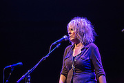 Singer-songwriter Lucinda Williams, wearing an aliigator pendant—a reminder of her native Louisiana—on stage at Celebrate Brooklyn.