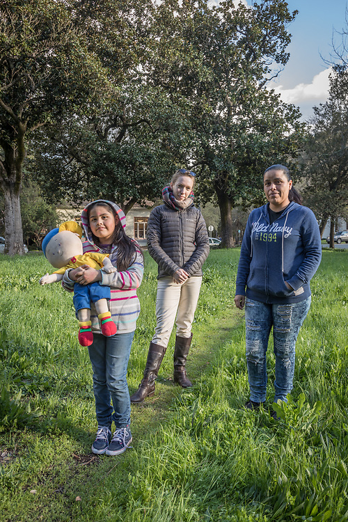 Hotel housekeeper and Calistoga resident Jazmine Rodrigues pauses near Lincoln Avenue with her seven year old daughter, Ashley, and family friend, Kathy Scott.