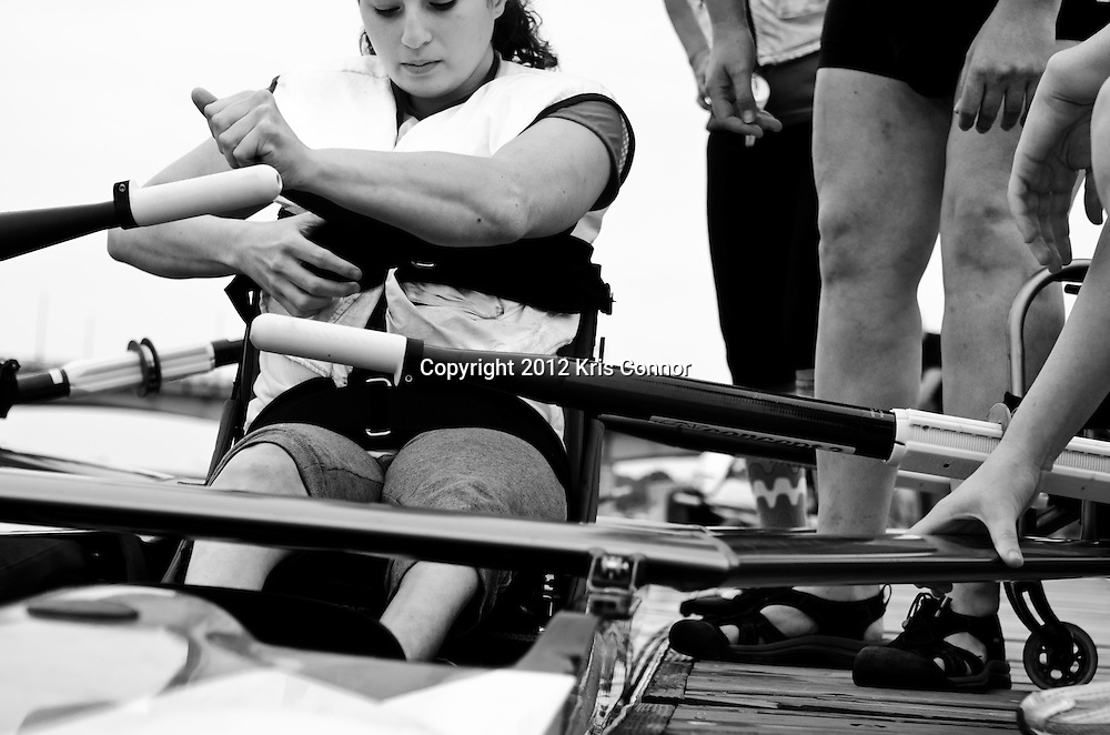 Dana uses straps herself into a specially design seat in the shell as she prepares for before a practice at the boat house on September 5th.