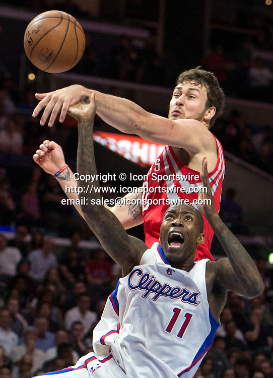 Feb. 11, 2015 - Los Angeles, CA, USA - Los Angeles Clippers' Jamal Crawford collides with Houston Rockets' Donatas Motiejunas as he drives the lane during the first half at Staples Center in Los Angeles on Wednesday