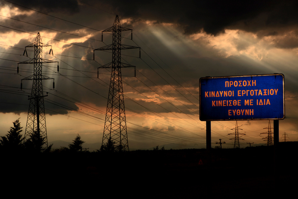 "Coal mines and power stations in Ptolemaida, a city located north of Kozani, in west Macedonia, northern Greece. .Sign at the surrounding area of the mine and the electric power factories ""Attention Danger, Moving to the area is your own responsibility"""