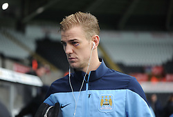 Manchester City's Joe Hart arrives at the Liberty Stadium with his eye in stitches.  - Photo mandatory by-line: Alex James/JMP - Tel: Mobile: 07966 386802 01/01/2014 - SPORT - FOOTBALL - Liberty Stadium - Swansea - Swansea City v Manchester City - Barclays Premier League