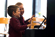 21/9/2011. News. New Ross Piano Festival. Junior infants from St Canices N.S. Rosbercon,  New Ross, Co Wexford get some practice in at the piano placed at the Dunbrody Visitors Centre, New Ross, From left, Jamie Connolly-Smith and Jack Allen all aged 4yrs. The 'PLAYME' Pianos are dotted around the town for the New Ross Piano Festival weekend - For a full programme see newrosspianofestival.com or visitwexford.ie - Photograph Patrick Browne<br />  <br /> For immediate release<br />  <br /> World Renowned Pianists Descend on New Ross for Sixth Annual Piano Festival<br /> September 22 to 25<br />  <br /> Eight internationally known pianists will descend upon the riverside town of New Ross this weekend for the sixth annual Piano Festival. The famous pianists will share the ivory keys with some budding musicians as ten pianos are dotted around the town in obscure locations such as the local supermarkets and the town hall for 'PLAYME' time at the festival.<br />  <br /> Visitors to the New Ross Piano Festival can expect double the fun as a spectacular two-piano weekend of classical concerts takes place for the first time from September 22 to 25. Critically acclaimed pianists Katya Apekisheva, Norikeo Ogawa, Kathryn Stott, Charles Owen, Igor Roma Finghin Collins, Fiachra Garvey, and Enrico Pace will all perform at the sixth festival in a spectacular two-piano weekend.<br /> Festival goers are in for a treat as the festival is hosting a day of concerts aimed at children and families, of 'Carnival of the Animals' on Friday, September 23 to celebrate 'National Culture Night'. Daytime performances for schoolchildren of Saint-Saens' 'Carnival of the Animals', supported by the National Concert Hall and narrated by actor Barry McGovern, as well as a free 6.30pm 'Opening Fanfare Concert' for everyone in association with Culture Night, featuring Rossini's 'William Tell' Overture and another performance of Carnival of the Animals [tickets necessary].  And on Friday and Saturday lunchtimes, Des Manahan will be play