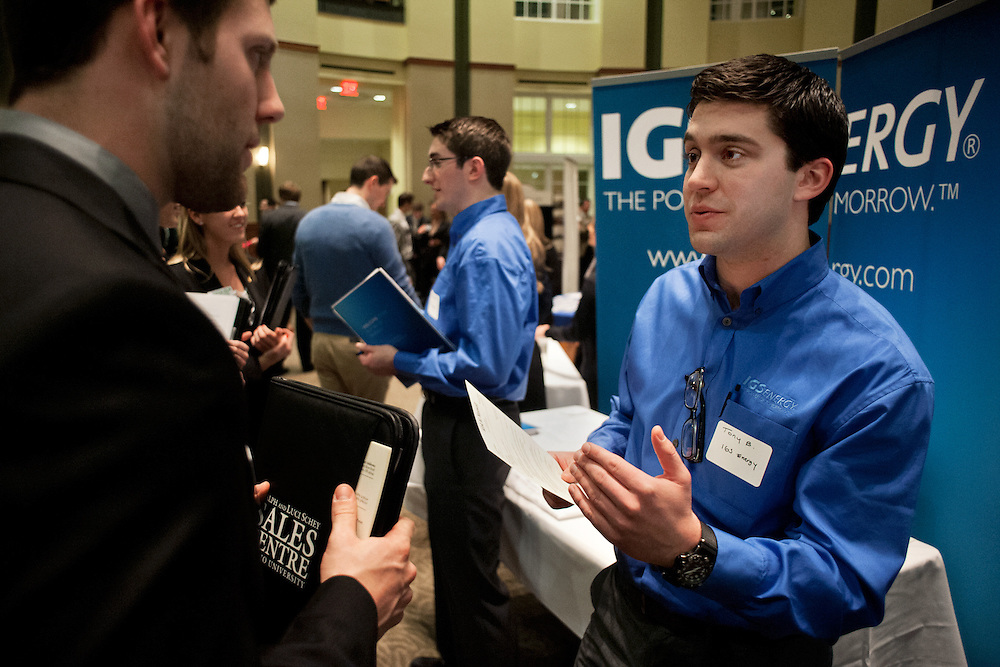 Tony Bravo (right) of IGS energy talks to Kirk Maxwell (left) during the career fair held by the Schey Sales Center on February 14th, 2012 in the Walter Hall Rotunda. Photo by: Ross Brinkerhoff.
