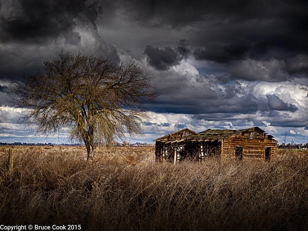 Old house under stormy skies