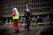 Oslo, Norway, 22.07.2011. An explosive device or most probably a car bomb was detonated outside the main government biuilding in the heart of Oslo, friday 22. of July. Several people are reported to have been killed. Assailant armed with automatic weapons later the same day attacked Utøya, an island south of Oslo where Stoltenberg's Labour party youth section's yearly gathering was taking place. Foto: Christopher Olssøn.