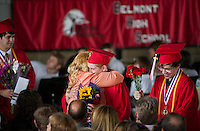 A sentimental journey for Belmont High School seniors as they deliver flowers to their loved ones in the audience during their graduation ceremony at Meadowbrook Pavilion Sunday morning.  (Karen Bobotas/for the Laconia Daily Sun)