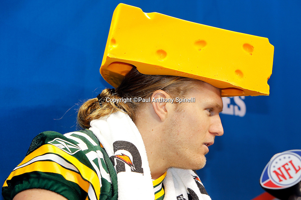 Green Bay Packers linebacker Clay Matthews (52) wears a cheese head hat as he speaks to the press at Super Bowl XLV media day prior to NFL Super Bowl XLV against the Pittsburgh Steelers. Media day was held on Tuesday, February 1, 2011 in Arlington, Texas. ©Paul Anthony Spinelli