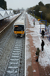© Licensed to London News Pictures.  18/01/2013. AYLESBURY, UK. Commuters wait to board a train at Stoke Mandeville Train Station. Train companies are operating a revised timetable following a Met Office amber warning for heavy snow for a large part of England. Photo credit :  Cliff Hide/LNP