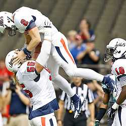 Sep 7, 2013; New Orleans, LA, USA; South Alabama Jaguars quarterback Ross Metheny (2) celebrates with offensive linesman Chris May (55)  following a touchdown run against the Tulane Green Wave during the first quarter of a game at the Mercedes-Benz Superdome. Mandatory Credit: Derick E. Hingle-USA TODAY Sports