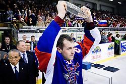 Tomaz Razingar of Slovenia with winning trophy at IIHF Ice-hockey World Championships Division I Group B match between National teams of Hungary and Slovenia, on April 23, 2010, in Tivoli hall, Ljubljana, Slovenia. (Photo by Matic Klansek Velej / Sportida)