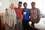 "Michaela DePrince at her home in Manhattan. ..vrnl: Michaela DePrince, ihre Adoptivmutter Elaine DePrince, Adoptivkinder Jestina und Mariel...Michaela DePrince was born in war-torn Sierra Leone on January 6, 1995 where she was named Named Mabinty Bangura. Her adoptive parents were told that her father was shot by rebels when she was three years old, and that her mother starved to death soon after. Frequently malnourished, mistreated, and derided as a ""devil's child"" because of vitiligo, a skin condition causing depigmentation, she fled to a refugee camp after her orphanage was bombed. In 1999, at age four, she and another girl, Mia, were adopted by Elaine and Charles DePrince from New Jersey, and taken to the United States. (source: Wikipedia)..Photo © Stefan Falke.www.stefanfalke.com"