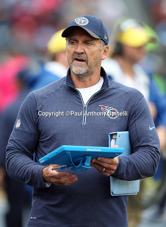 Tennessee Titans special teams assistant Steve Hoffman calls out from the sideline while holding a play tablet during the 2015 week 7 regular season NFL football game against the Atlanta Falcons on Sunday, Oct. 25, 2015 in Nashville, Tenn. The Falcons won the game 10-7. (©Paul Anthony Spinelli)