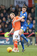 Luton Town striker Craig Mackail-Smith and Ryan Sweeney of AFC Wimbledon during the Sky Bet League 2 match between AFC Wimbledon and Luton Town at the Cherry Red Records Stadium, Kingston, England on 13 February 2016. Photo by David Vokes.