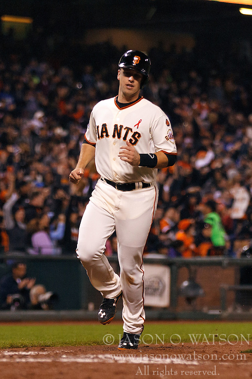 SAN FRANCISCO, CA - MAY 20:  Buster Posey #28 of the San Francisco Giants scores a run against the Los Angeles Dodgers during the sixth inning at AT&T Park on May 20, 2015 in San Francisco, California.  (Photo by Jason O. Watson/Getty Images) *** Local Caption *** Buster Posey