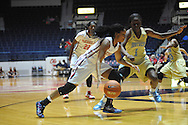 "Ole Miss guard Toree Thompson (1) vs. Southern University Jaguars guard Briana Green (1) at the C.M. ""Tad"" Smith Coliseum in Oxford, Miss. on Thursday, November 20, 2014. (AP Photo/Oxford Eagle, Bruce Newman)"
