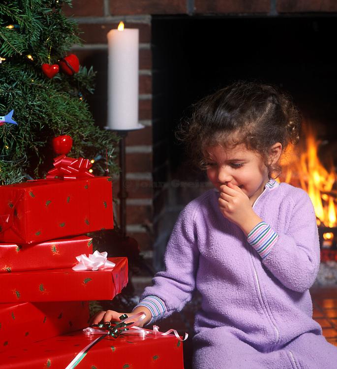 Waiting for Santa.  Christmas presents and Christmas Tree