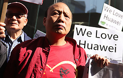 December 18, 2018 - Hong Kong, CHINA - Pro-China demonstrators gather downstair of Canadian Consulate General in Central, calling for immediate releasing of Meng Wanzhou.Dec-18,2018 Hong Kong.ZUMA/Liau Chung-ren (Credit Image: © Liau Chung-ren/ZUMA Wire)
