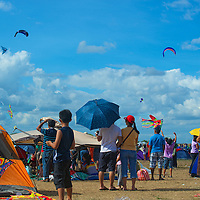 A sky filled with kites, balloons and other objects during the 18th Philippine International Hot Air Balloon Fiesta