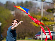 19 APRIL 2020 - DES MOINES, IOWA: MICHAEL CARTER, from Des Moines, flies a kite at Gray's Lake, a popular public park and lake south of downtown Des Moines. After a week of colder than normal weather, including three inches of snow, the weekend was spring like and people went to public parks to enjoy the pleasant weather.       PHOTO BY JACK KURTZ