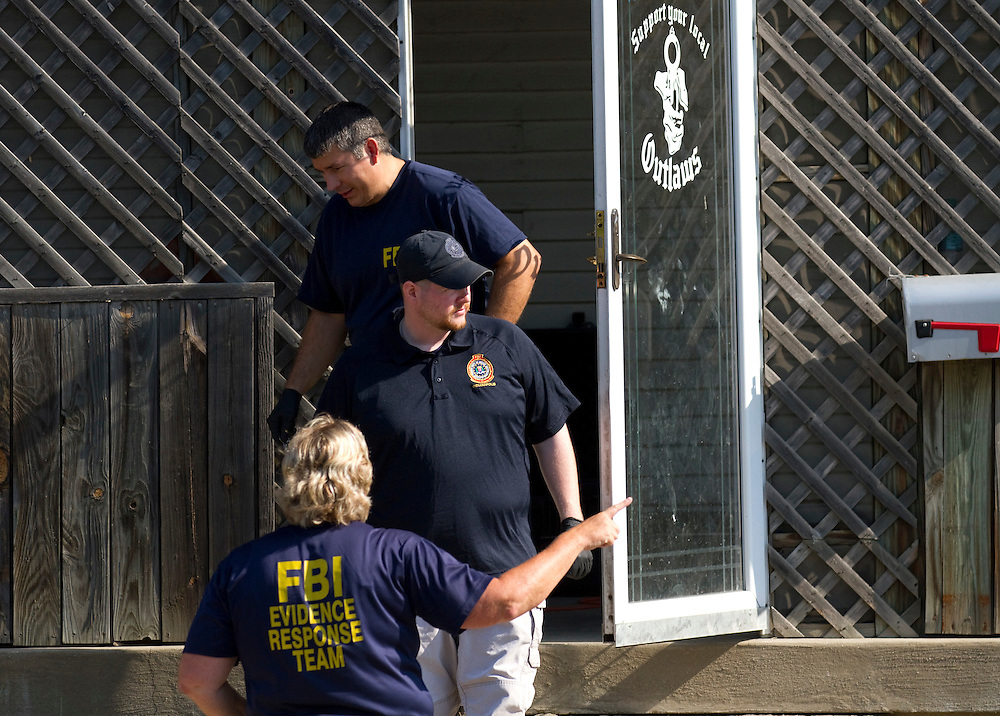 The FBI carries out a raid on the Outlaws Motorcycle Club in Indianapolis Wednesday morning. 43 Outlaws were named in arrest warrants according to local news sources. The raid also included a Ft. Wayne, Ind. clubhouse. .Photo by Chris Bergin