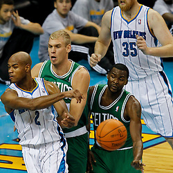 December 28, 2011; New Orleans, LA, USA; New Orleans Hornets point guard Jarrett Jack (2) passes the ball away as Boston Celtics center Greg Stiemsma (54) and guard Keyon Dooling (51) defend during the second quarter of a game at the New Orleans Arena. The Hornets defeated the Celtics 97-78.   Mandatory Credit: Derick E. Hingle-US PRESSWIRE