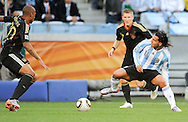CAPE TOWN, SOUTH AFRICA- Saturday 3 July 2010, Carlos Tevez challenges Jerome Boateng during the quarter final match between Argentina and Germany held at the Cape Town Stadium in Green Point during the 2010 FIFA World Cup..Photo by Roger Sedres/Image SA