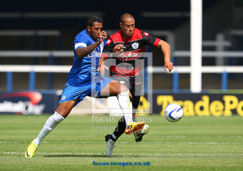 Picture by Rob Fisher/Focus Images Ltd +44 7450 945824<br /> 13/07/2013<br /> Nathaniel Mendez-Laing of Peterborough United and Bobby Zamora of Queens Park Rangers battle for the ball during the pre season friendly match at London Road, Peterborough.