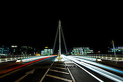 Evening rush hour traffic on the Samuel Beckett Bridge over the Liffey River, in Dublin Ireland Constructed by Graham Hollandia Joint Venture, and designed by Spanish architect Santiago Calatrava. The bridge is 120 metres long and 48 metres high and weighs 5,700 tonnes.