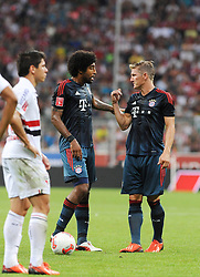 31.07.2013, Allianz Arena, Muenchen, Audi Cup 2013, FC Bayern Muenchen vs Sao Paulo, im Bild, DANTE (FC Bayern Muenchen) und Bastian SCHWEINSTEIGER (FC Bayern Muenchen) im Gespraech bei einem Freistoss // during the Audi Cup 2013 match between FC Bayern Muenchen and Sao Paulon at the Allianz Arena, Munich, Germany on 2013/07/31. EXPA Pictures © 2013, PhotoCredit: EXPA/ Eibner/ Wolfgang Stuetzle<br /> <br /> ***** ATTENTION - OUT OF GER *****