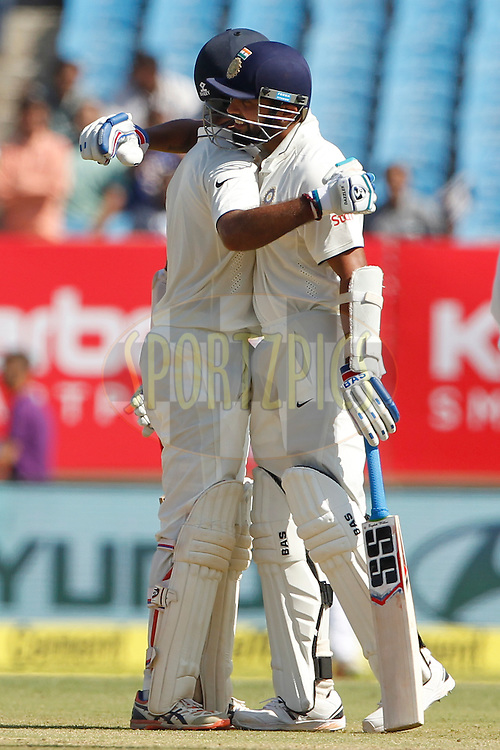Cheteshwar Pujara of India celebrates his Fifty with Murali Vijay of India during day 3 of the first test match between India and England held at the Saurashtra Cricket Association Stadium , Rajkot on the 11th November 2016.<br /> <br /> Photo by: Deepak Malik/ BCCI/ SPORTZPICS
