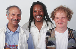 Multiracial group of men standing together smiling,
