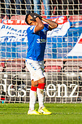 Alfredo Morelos (#20) of Rangers FC has his head in his hands after seeing his shot being deflected just wide of goal during the Ladbrokes Scottish Premiership match between Heart of Midlothian and Rangers FC at Tynecastle Park, Edinburgh, Scotland on 20 October 2019.