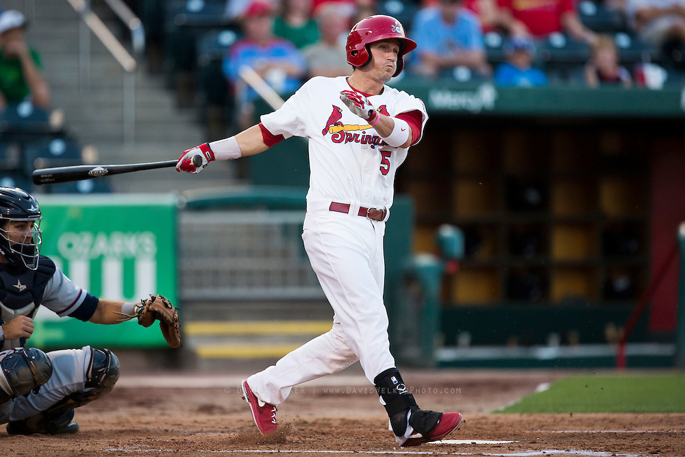 Colin Walsh (5) of the Springfield Cardinals follows through his swing after making contact with a pitch during a game against the Northwest Arkansas Naturals at Hammons Field on August 20, 2013 in Springfield, Missouri. (David Welker)