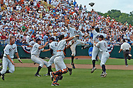 Sports Illustrated -- Cal State Fullerton players take to the air in Omaha after their stunning sweep of Texas in the College World Series.
