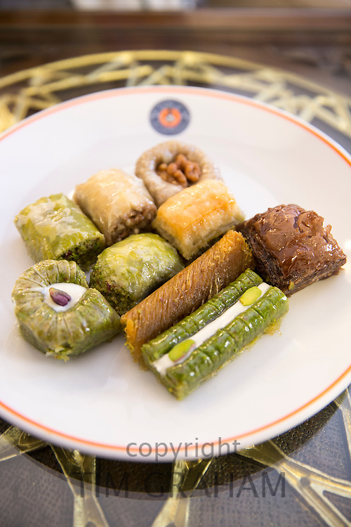Plate of traditional Turkish honey-covered baklava sweetmeats, a dessert of filo pastry and nuts, Istanbul, Turkey