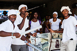 "UVI actors and the Artaura Foundation, Inc. directed by miss Kathleen Pascal reenact a scene of the 1892 Coal Workers' Strike.  (L-R) Yohance Henley, Phillip Thomas, and Noel Charles.  7th Annual Dollar Fo' Dollar Culture & History Tour & MIni Coaling Exhibit.  In remebrance of the 1892 Coal Workers Strike on St. Thomas ""livicated"" to Ras Jahstarr Koniyah.  Held annually in September, the tour celebrates the successful protest of 19th centry coal laborers in the streets of downtown Charlotte Amalie for better pay.  Mary Ann Christopher plays the role of Queen Coziah who led the successful revolt.  © Aisha-Zakiya Boyd"