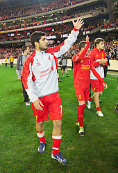MELBOURNE, AUSTRALIA - Wednesday, July 24, 2013: Liverpool's Luis Suarez waves to the supporters after his side's 2-0 victory over Melbourne Victory during a preseason friendly match at the Melbourne Cricket Ground. (Pic by David Rawcliffe/Propaganda)