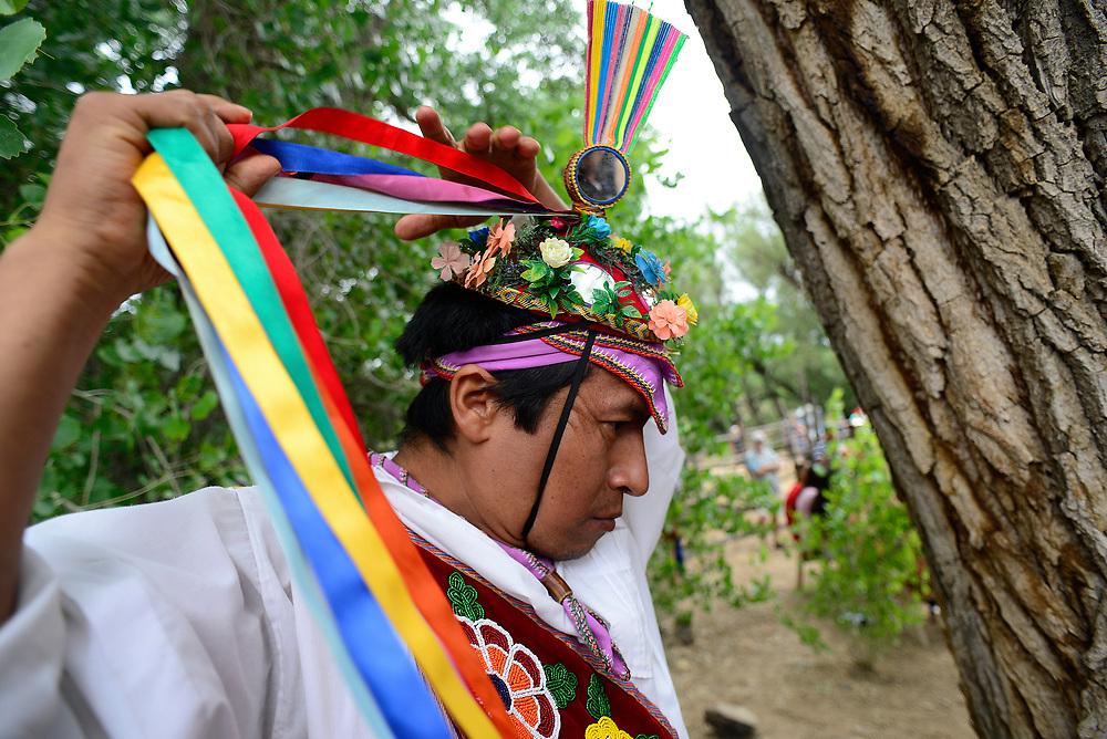 apl072317c/ASECTION/pierre-louis/JOURNAL 072317<br /> Javier Santo,,of Veracruz, Mexico,  a member of Grupo de Voladores de Papantla adjusts his hat before performing at  the 10th Annual &quot;Viva Mexico Fiesta &quot; held at El Rancho de las Golondrinas .Photographed on Sunday July  23,  2017. .Adolphe Pierre-Louis/JOURNAL