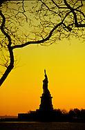 New York. Statue of liberty  at sunset New York  Usa /  la statue de la liberte au coucher du soleil.