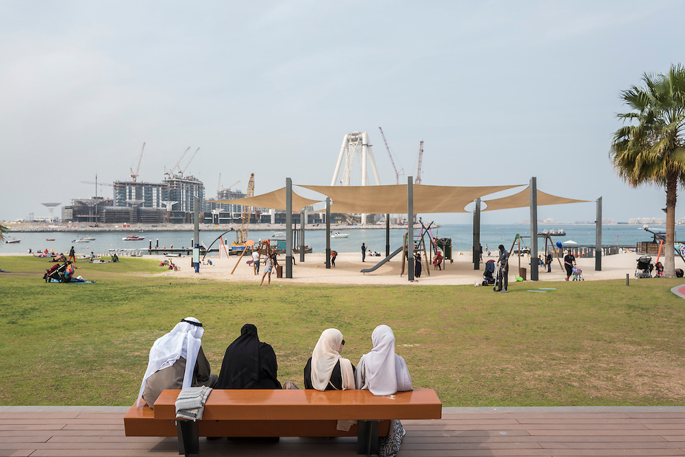 DUBAI, UAE — JANUARY 19, 2017: Boardwalk at Jumeirah Beach Residence (JBR) located in Dubai Marina. In the background is the construction of the Blue Water Islands.