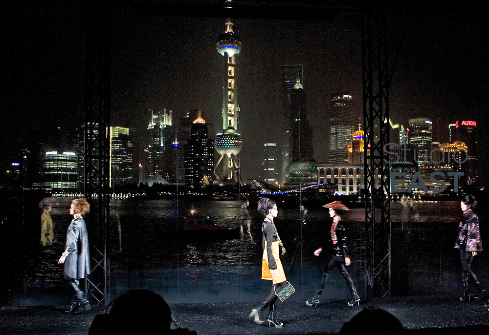 Models walk the catwalk in front of the famous Shanghai Pudong panorama at Chanel Fashion Show in Shanghai, on December 3, 2009. Photo by Lucas Schifres/Pictobank
