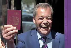 © Licensed to London News Pictures. 20/05/2016. London, UK.  UK Independence Party leader Nigel Farage waves his EU passport as he launches his EU referendum tour and bus. Campaigning by parties for and against the United Kingdom's membership of the European Union is well under way ahead of polling day on June 23, 2016. Photo credit: Peter Macdiarmid/LNP